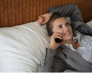 woman talking on phone on bed 400 correct